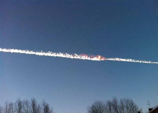 Trail of a falling object is seen above the Urals city of Chelyabinsk